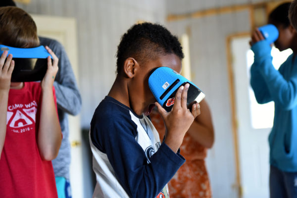 Youth experiences virtual reality goggles